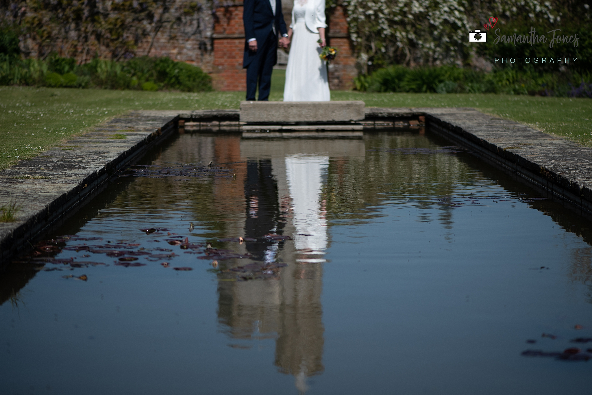 bride and groom reflected at Goodnestone Park