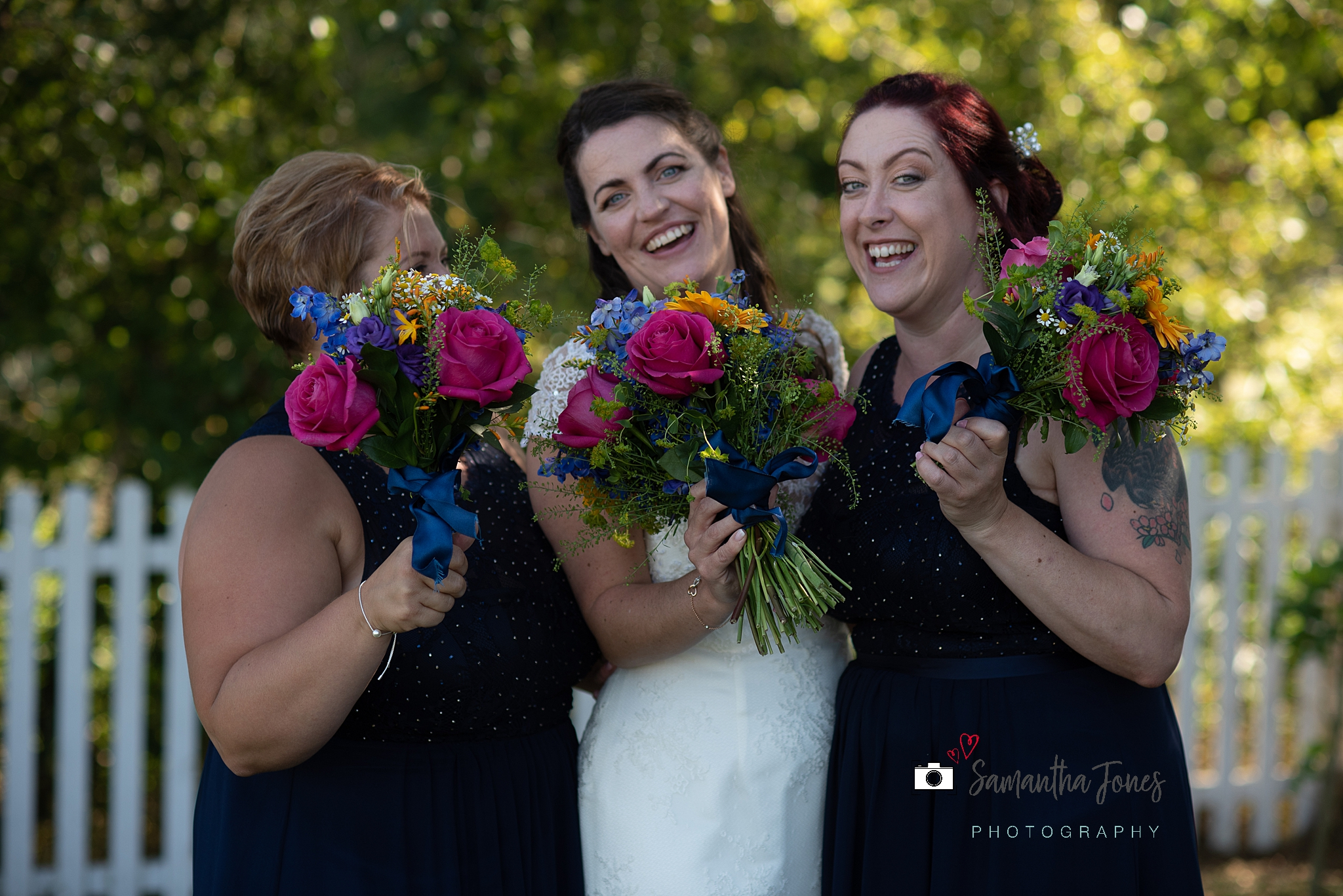bride and bridesmaids floral bouquets Kent wedding at Stonelees by Samantha Jones Photography