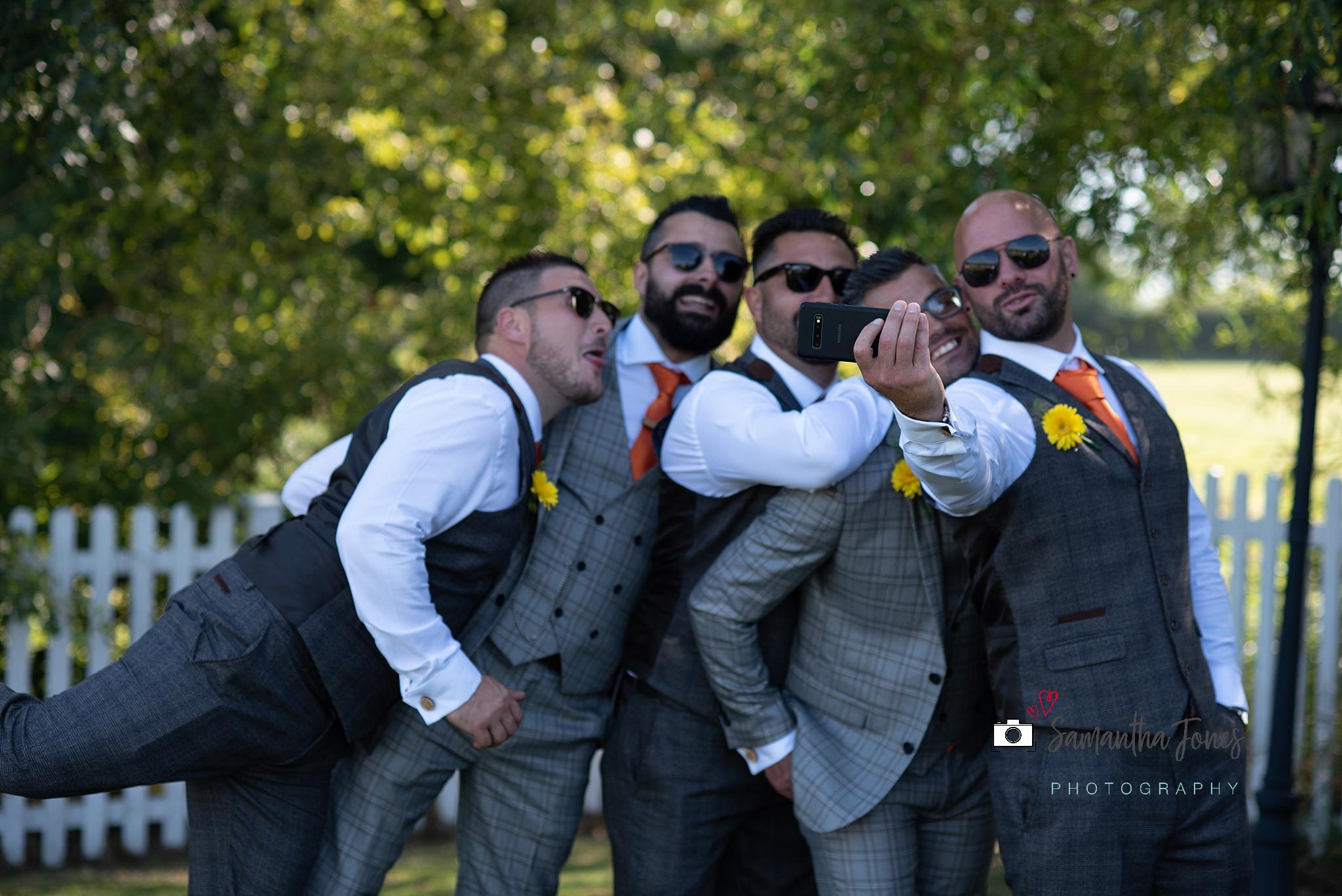 laughing groomsmen taking selfies Kent wedding at Stonelees by Samantha Jones Photography