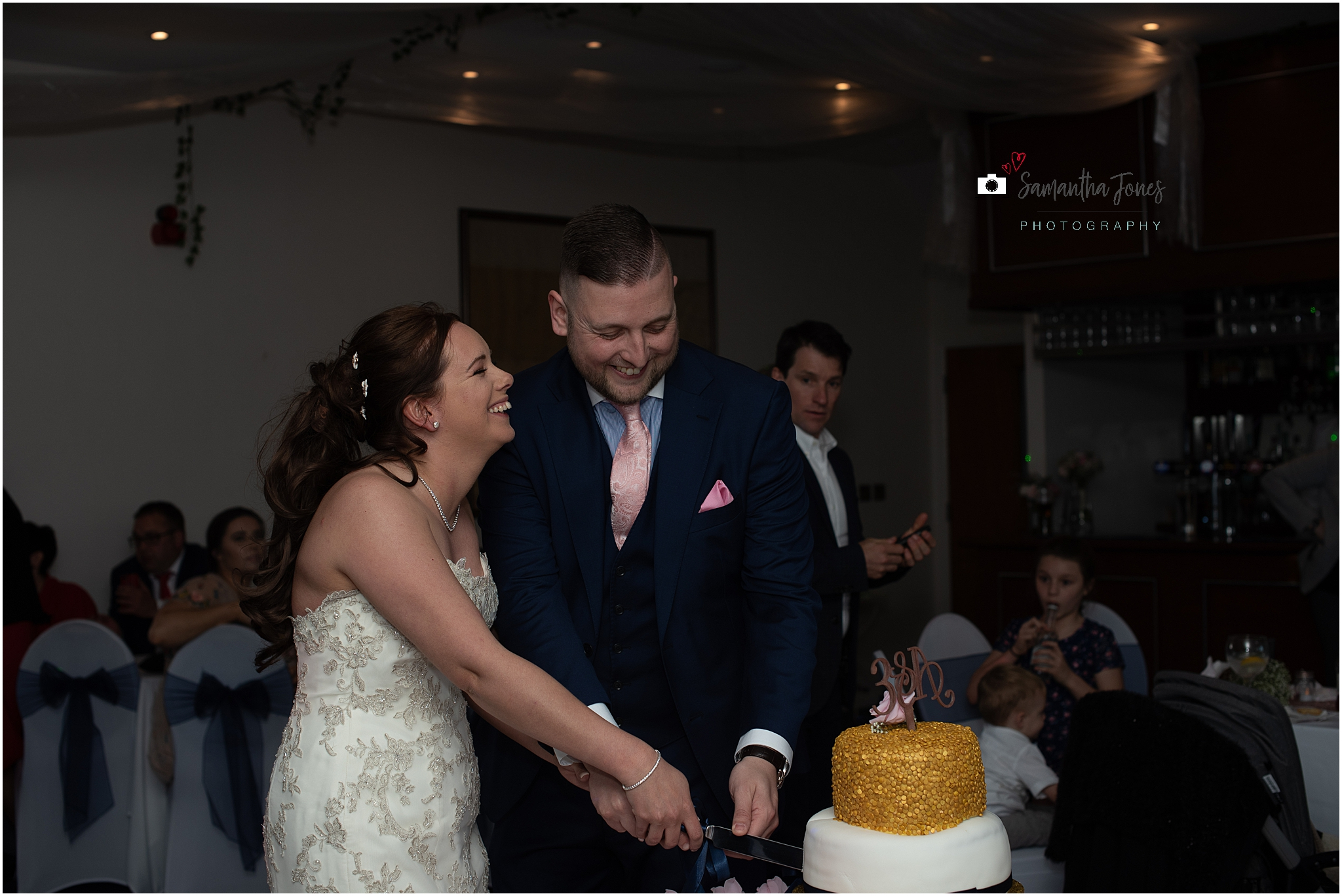 Emma and Aaron twilight wedding at Stonelees cake cutting