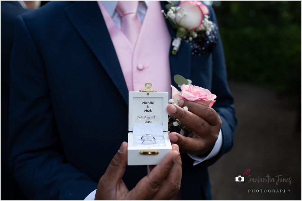 wedding rings held by best man