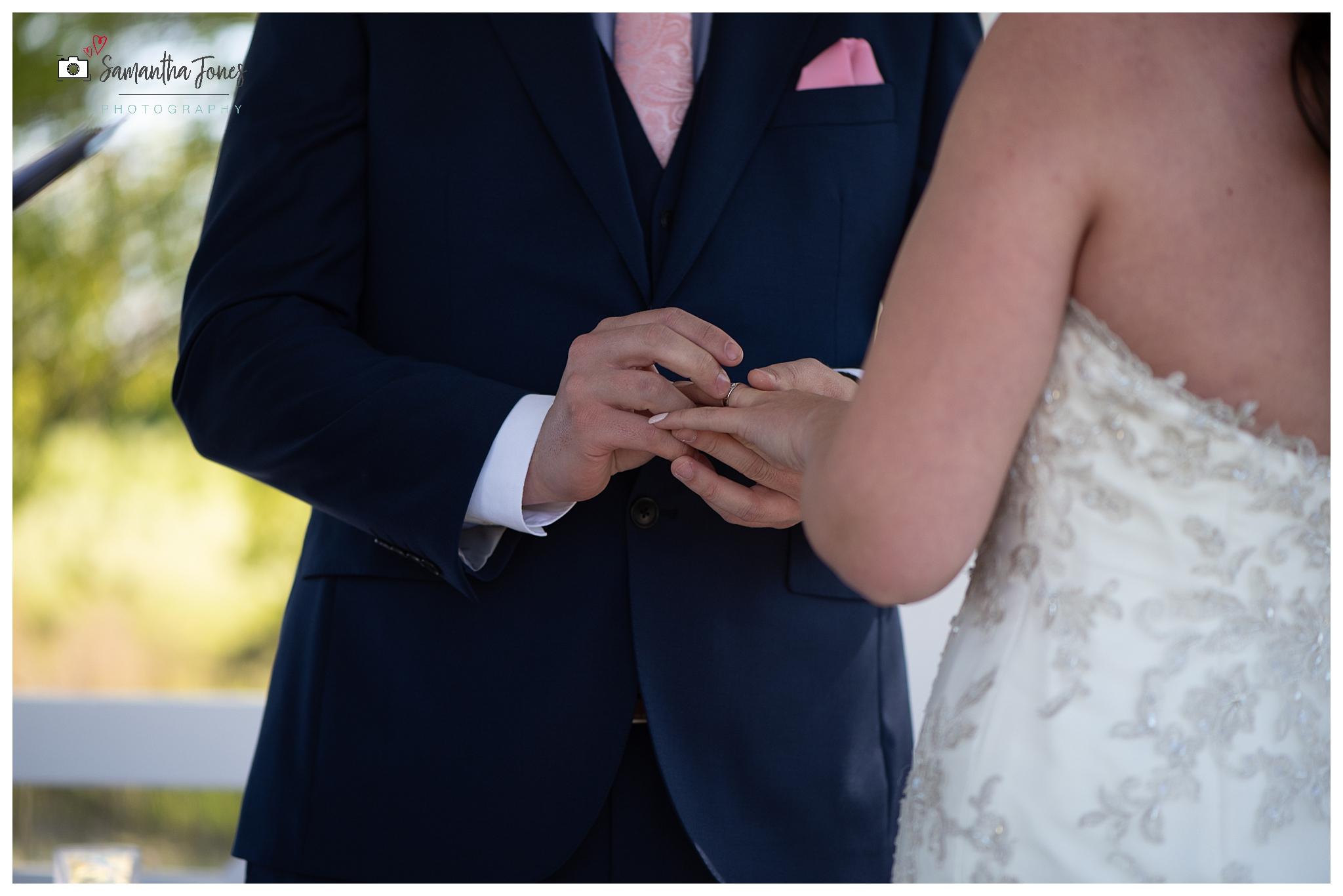 Emma and Aaron twilight wedding at Stonelees exchange of rings
