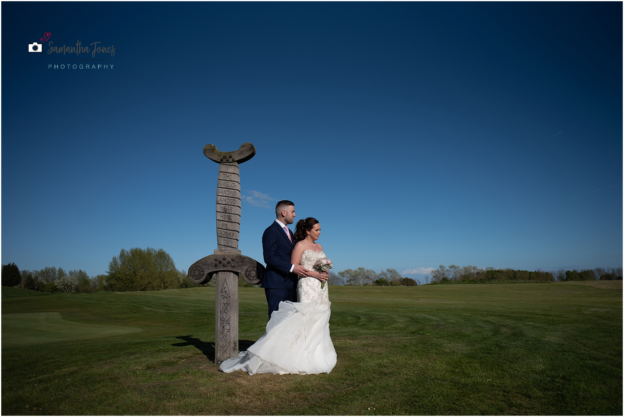 Emma and Aaron twilight wedding at Stonelees portraits by the Viking sword