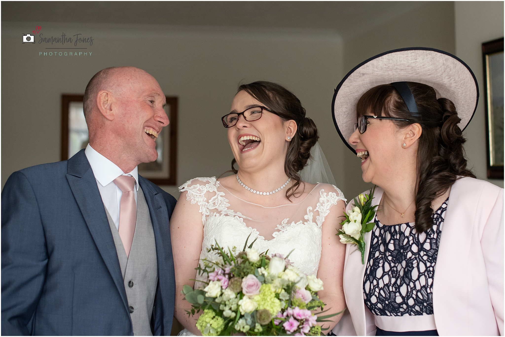 bride laughing with parents