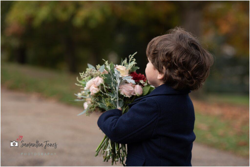 cute boy with wedding bouquet