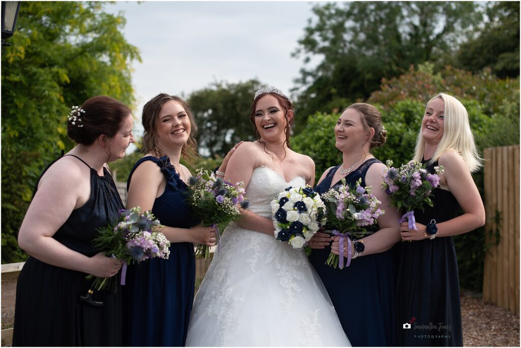 bride and brides laughing