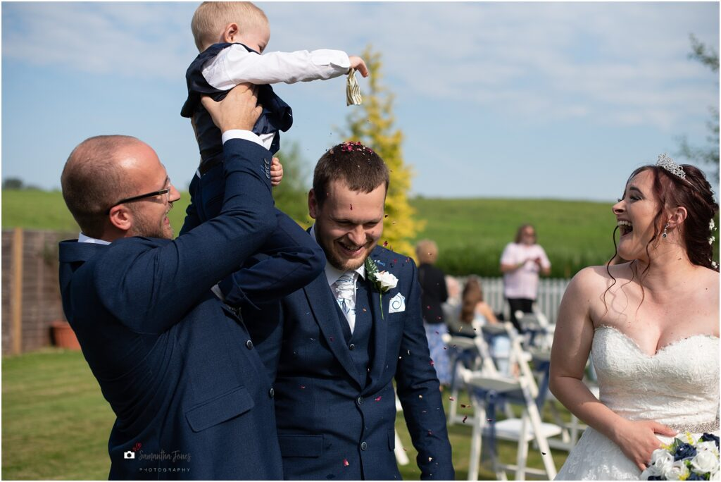 pageboy scattering confetti on groom