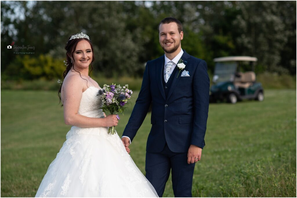 bride and groom with golf buggy