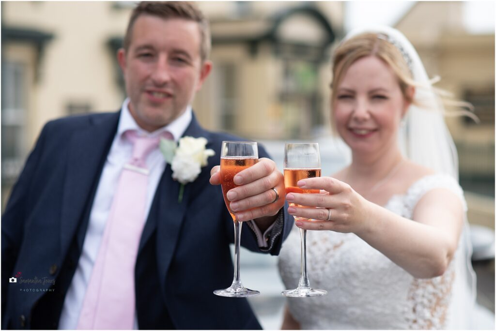 bubbles on arrival of bride and groom for their third time's a charm wedding