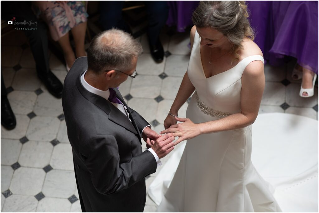 bride and groom exchanging rings at Mount Ephraim