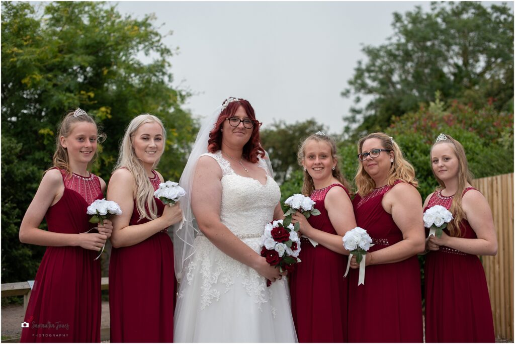 bridal party, bridesmaids in red gowns