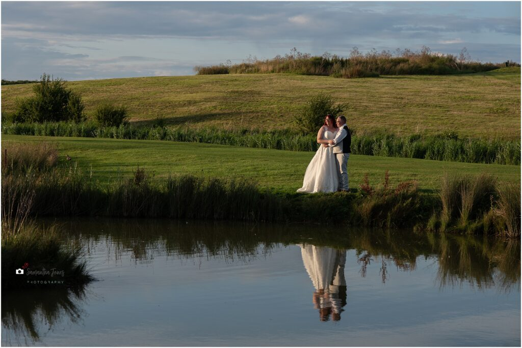 bride and groom photographs after a huge thunderstorm